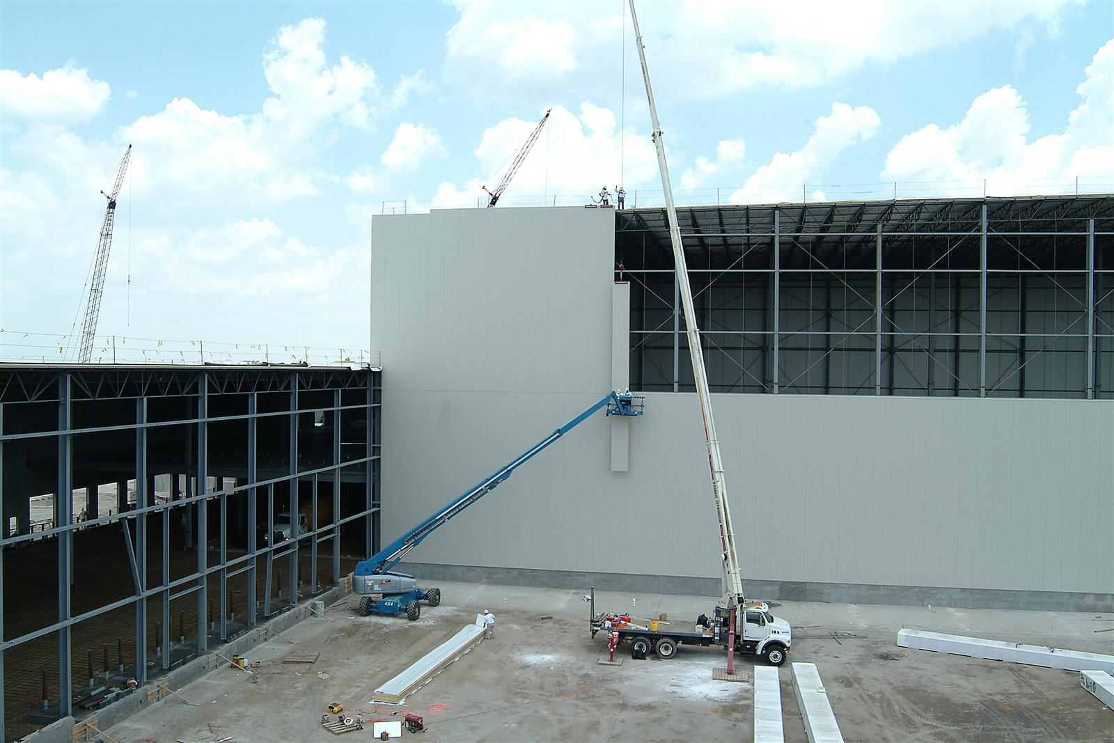 Six key benefits of insulated metal panel walls stellar for Panel house construction